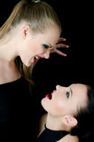Two beautiful girls shout and swear Royalty Free Stock Photos