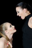 Two beautiful girls shout and swear Royalty Free Stock Image