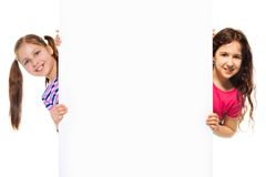 Two girls and information billboard Royalty Free Stock Images