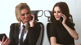 Two Beautiful Girls Sitting and Talking to Their Clients at The Office stock footage