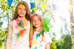 Two beautiful girls smeared with colored powder Royalty Free Stock Photos