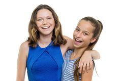 Two beautiful girls smile with perfect white smile, isolated on white background.  stock image
