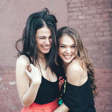 Two beautiful girls smiling on a sunny day Stock Images