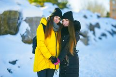 Two beautiful girls stand side by side, informal love, lgbt royalty free stock photo