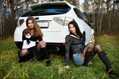 Two beautiful girls and stylish white sports car Royalty Free Stock Photography
