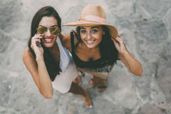 Two beautiful girls in summer clothes Stock Photo