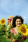 Two beautiful girls in sunflower Stock Photo
