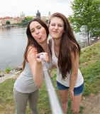 Two beautiful girls taking a selfie Royalty Free Stock Images