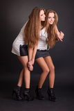 Two beautiful girls twins, isolated on black Stock Photography