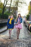 Two beautiful girls walking together and chatting Royalty Free Stock Photography