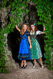 Two beautiful girls wearing Dirndl Stock Images