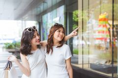 Two beautiful girls window shopping in the city royalty free stock photo