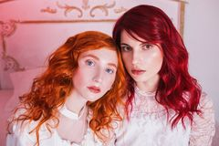 Free Two Beautiful Girls With Red Hair In A Beautiful White Wedding Victorian Dresses Stock Photos - 106182753