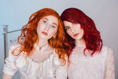 Free Two Beautiful Girls With Red Hair In A Beautiful White Wedding Victorian Dresses Stock Photography - 106183072