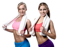 Two beautiful girls after workout with towels Stock Photo