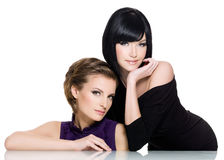Two beautiful glamour young women royalty free stock photography