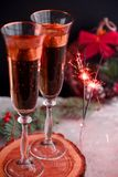 Two glass champagne glasses.Two beautiful glass champagne glasses on New Year`s Eve.painted in the fashionable color of 2019. Two beautiful glass champagne royalty free stock photo