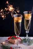 Two glass champagne glasses.Two beautiful glass champagne glasses on New Year`s Eve royalty free stock images