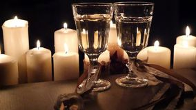 Two beautiful glass of wine and ribbons against a background of candles, HD. Two beautiful glass of wine and ribbons against a background of candles stock video