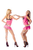 Two beautiful go-go girl in pink costumes Royalty Free Stock Image