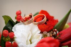 Two beautiful gold rings on wedding bouquet Stock Photos