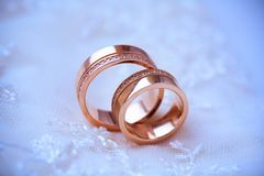 Two beautiful golden rings Stock Photos