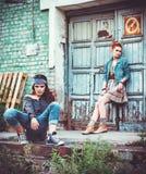 Two beautiful grunge girls among industrial ruins Royalty Free Stock Image