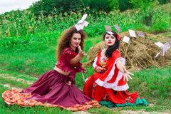 Two beautiful gypsy girls throwing cards Stock Photo