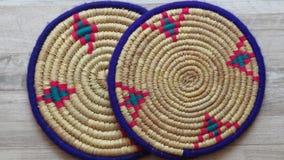 Northern Iran handicraft. Two Beautiful Handmade Woven Bamboo / Cane Trays. Two Beautiful Handmade Woven Bamboo / Cane Trays with Colourful Woollen Elements royalty free stock photography
