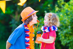 Two beautiful happy kids Dutch football supporters Royalty Free Stock Photos