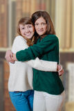 Two beautiful happy teenage girls in home made Stock Photography
