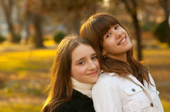 Two beautiful happy teenage girls in the park Royalty Free Stock Photography