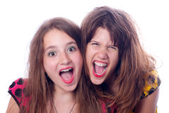 Two beautiful happy teenage girls screaming. Isolated on white Royalty Free Stock Images