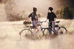 Two beautiful hipsters standing outdoor. In summer with white vintage fixed gear bicycle royalty free stock photos