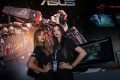 Two beautiful hostesses at Games Week 2013 in Milan, Italy. MILAN, ITALY - OCTOBER 26: Two beautiful hostesses pose at Games Week 2013, event dedicated to video Royalty Free Stock Image