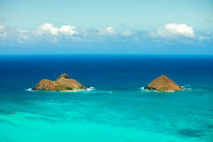 Two beautiful islands on a calm day perfect for water-sports and relaxation. Shot of two islands in Hawaii on a sunny day Stock Photos