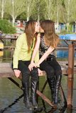 Two beautiful kissing girls. On a mooring Stock Images