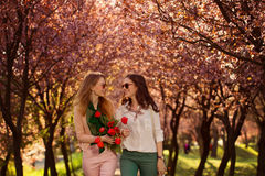 Two beautiful ladies in spring park Royalty Free Stock Images