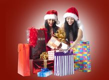 Two beautiful ladys and gifts Stock Photo