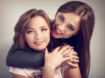 Two beautiful laughing girl friends hugging with love with rings Royalty Free Stock Images