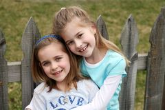 Two beautiful little blond girls Stock Photos