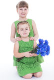 Two beautiful little girl with a beautiful bouquet Royalty Free Stock Images