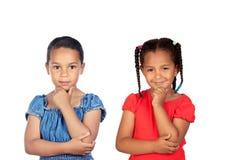 Two beautiful little girls thinking Stock Photography