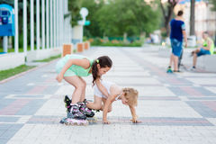 Two beautiful little sisters in a roller skates Royalty Free Stock Photos