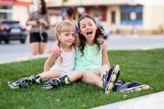 Two beautiful little sisters in a roller skates Royalty Free Stock Photography