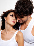 Two beautiful lovers. Portrait of a two flirting beautiful lovers. People with brown hairs Royalty Free Stock Photography