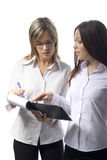 Two beautiful manager women. Write nots on white background Royalty Free Stock Photography