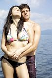 Two beautiful model in the sea getting tanned in love Stock Photo