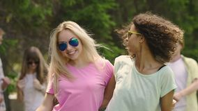 Two beautiful multiethnic girls having fun at summer party, posing for selfie. Stock footage stock video