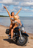Two beautiful naked women with motorcycle Royalty Free Stock Photo